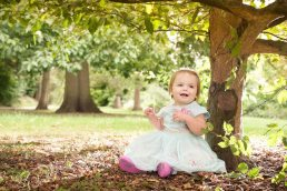family-portraits-leamington-spa-toddler sat by tree