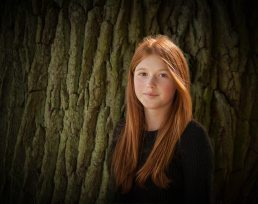 Family-photographer-teenage girl by a tree - Warwickshire