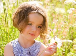 children photography Warwickshire - Laurence Jones - girl and flowers