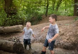 Family photography- jumping in a stream in Warwickshire