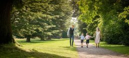 Family walking together in the landscape, photographed in Worcestershire
