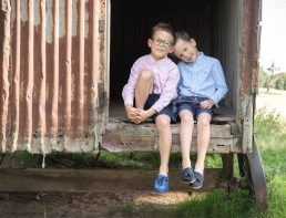 Brothers in old gypsy caravan on family photoshoot near Worcester