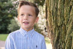 Boy by tree on family photoshoot near Worcester