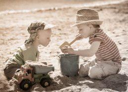 On the beach by international family Photographer